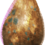 A lumpy, brown egg with green speckles.